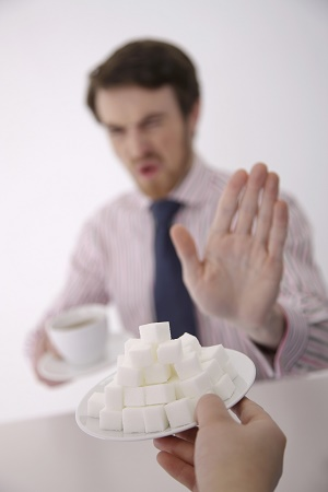 man saying no to sugar